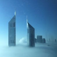Emirates Towers hotel high above an early morning mist ...Dubai...