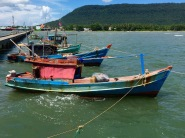 Fishing boats moored on the long jetty...