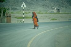 Bedouin lady crossing the road out in the south of the island...