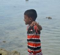 My little friend offering a sea slug....