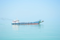 One of the old style ferries on a glassy sea...