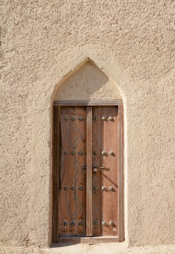 Beautiful wooden doors at Siyja fort, Abu Dhabi region, UAE.