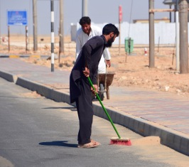 Optimistically sweeping the desert sand off the road...