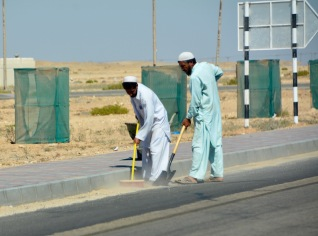 and sweeping the other side of the road... was the sand being swept across to the other side ?