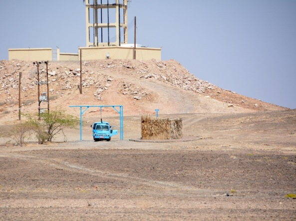 Bright turquoise blue water trucks, filling up at a water storage stop, Unmissable, hence the photograph...