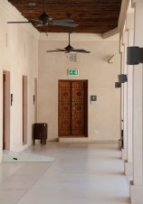 The cool covered walkway around the building inside the courtyard, plenty of doors...