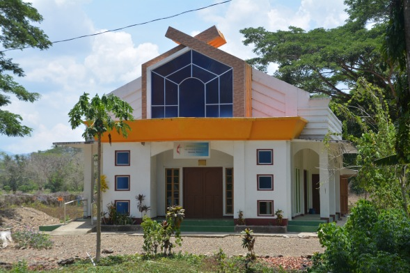 A roadside church on the Southern highway, colourful and with windows....