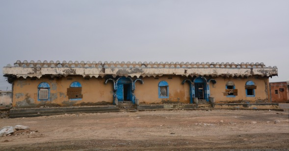 A long-abandoned villa, left to the elements, but check out the over-door design...an influence from where? .....