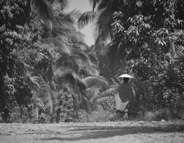 Caught this lady on a bumpy jungle trail in the Philippines, like a ghost she appeared and disappeared into the jungle..... B&W makes the contrast evocative...who knows why she was there or where she was going...