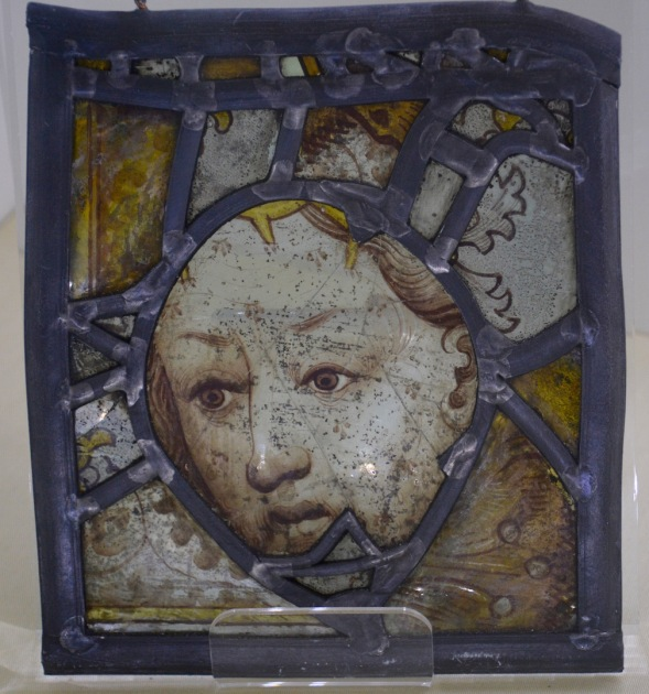 Preserved portion of stained glass from 13th century, the detail on the face...