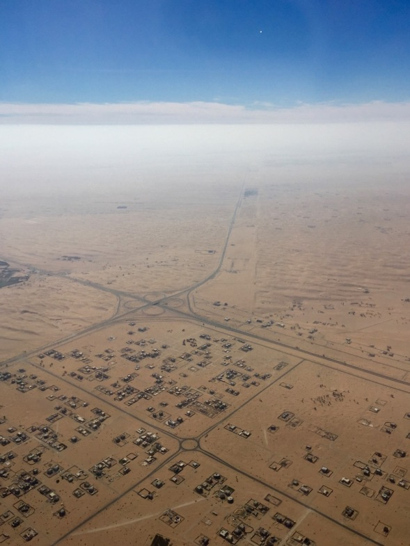 across the sand...it's such a vast flat expanse east of Dubai...
