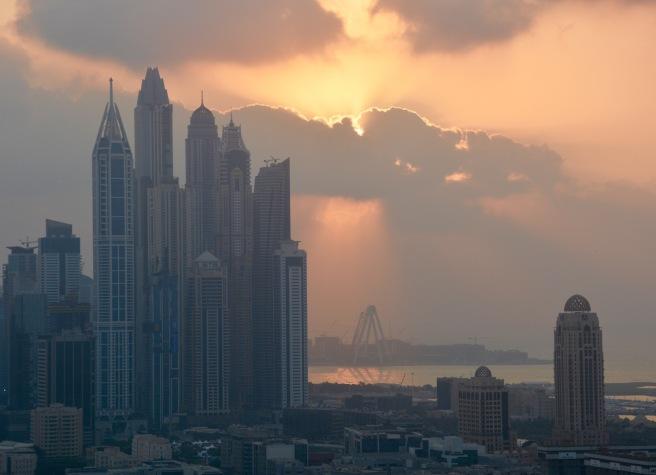 The sun going down over Dubai marina 8/12/16....