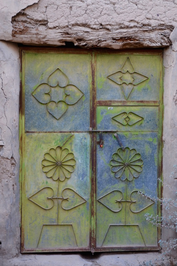 Metal work doors, turned pastel by the elements...