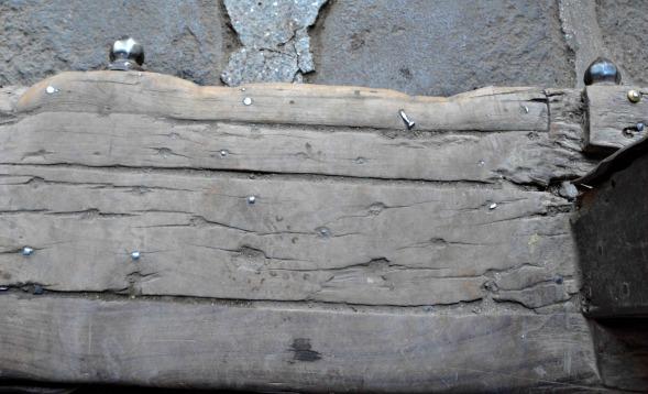 The door-step, worn by centuries of feet...